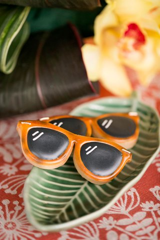 tropical-wedding-inspiration-shoot-with-palm-plate-and-orange-rayban-sunglasses-cookies