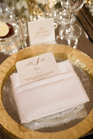 wedding-reception-gold-rim-charger-plate-white-folded-napkin-rounded-corner-menu-card-gold-monogram