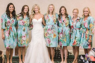 bride-in-a-strapless-hayley-paige-dress-with-bridesmaids-in-blue-robes-with-flowers