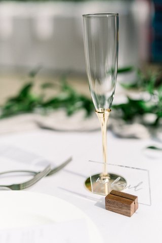 acrylic-wedding-place-card-in-wood-stand-champagne-flute-with-gold-stem