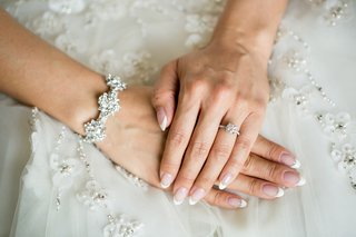 bride-with-almond-nails-french-manicure-with-rhinestone-detail-diamond-bracelet-round-solitaire