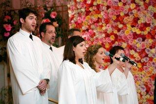 men-and-women-in-white-robes-singing-at-wedding