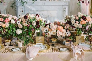 ranunculus-centerpieces-in-ivory-blush-maroon-eggplant