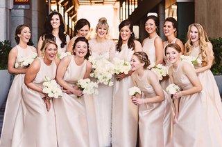 bride-in-monique-lhuillier-bridesmaids-in-pale-blush-satin-alfred-sung