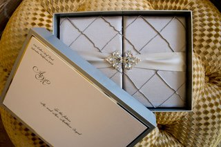 wedding-invitation-front-of-box-with-ribbon-and-brooch-detail