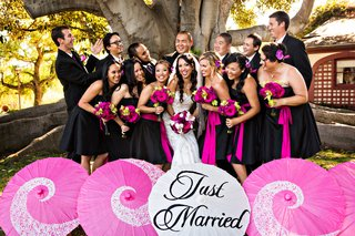bride-and-groom-with-wedding-party-and-pink-just-married-parasols