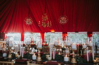 burgundy-wedding-reception-tent-with-chandeliers