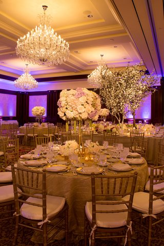 ballroom-wedding-reception-with-tall-flower-arrangements-and-cherry-blossom-tree-decorations