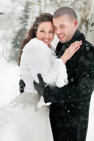 couple-in-jackets-during-snow-storm