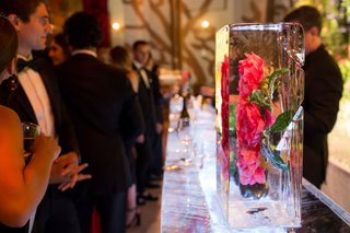 wedding-reception-unique-decor-pink-peony-rose-flower-frozen-in-large-ice-cube-at-ice-sculpture-bar