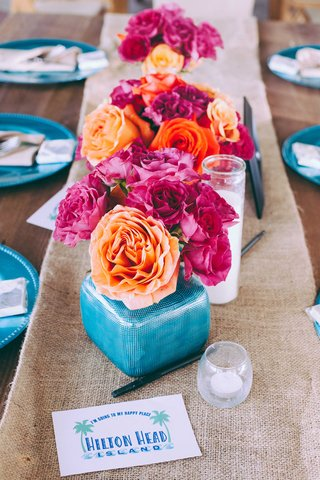 vibrant-wedding-decorations-on-burlap-table-runner-at-hilton-head
