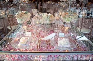 view-of-wedding-sweetheart-table-silver-pink-rose-petals-crystals-charger-low-centerpieces