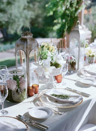 shabby-chic-lanterns-with-spring-flowers-in-glass-and-ceramic-vases