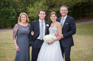 newlyweds-with-mother-of-the-bride-and-father-of-the-bride