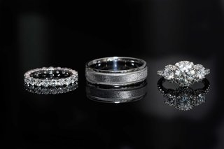 halo-diamond-engagement-ring-with-three-stones-diamond-eternity-band-mens-band