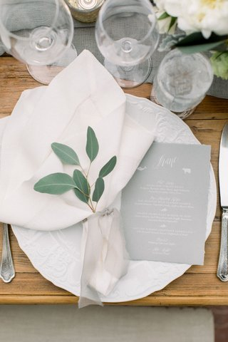 wedding-reception-wood-table-eucalyptus-greenery-in-napkin-sheer-ribbon-china-grey-menu-card-white
