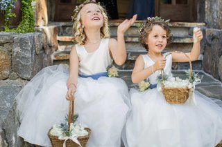 flower-girls-with-baskets-and-flower-crowns-white-dresses-with-blue-sashes