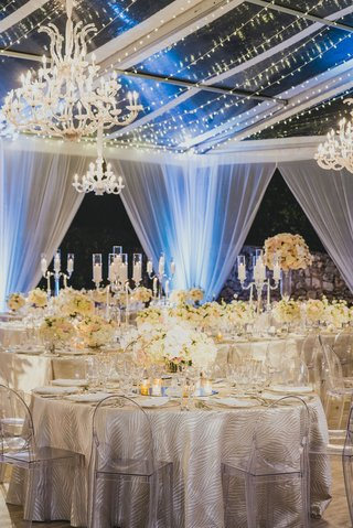 clear-top-reception-tent-with-drapery-twinkle-lights-and-chandliers
