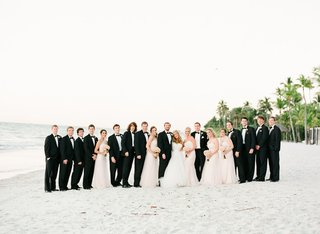 bride-and-groom-with-bridal-party-on-a-beach-in-naples-fl