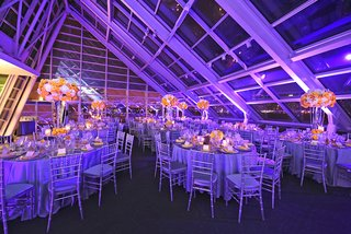 wedding-reception-with-purple-lighting-lilac-satin-linens-yellow-roses-white-hydrangeas