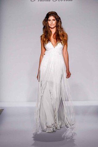 pnina-tornai-for-kleinfeld-2016-deep-v-wedding-dress-with-fringe-empire-waist-skirt
