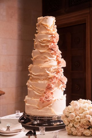 wedding-cake-with-multiple-layers-blush-flowers-ruffles-persian-wedding-cake-flavors