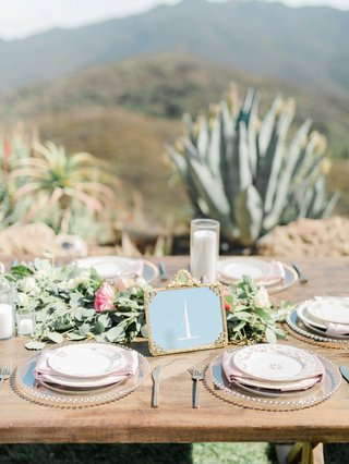 wedding-reception-megan-nicole-youtube-singer-wood-table-outdoor-wedding-greenery-pink-flowers-gold