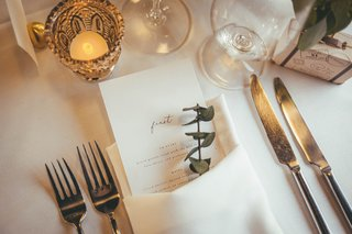 wedding-menu-that-says-feast-paired-with-sprig-of-eucalyptus