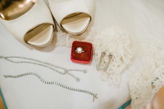 white-high-heeled-shoes-white-lace-red-ring-box-silver-jewelry-ring-bracelets-earrings-necklace