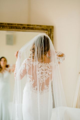bride-in-pronovias-wedding-dress-with-lace-illusion-back-long-veil
