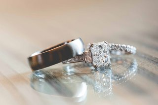 three-stone-emerald-cut-engagement-ring-with-grooms-brushed-finished-band-and-brides-diamond-band