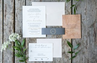 wedding-invitation-with-gold-calligraphy-grey-belly-band-and-wood-grain-card