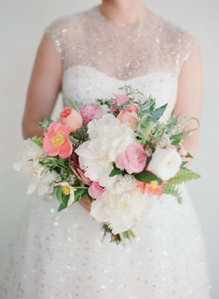bride-in-sparkle-gold-dress-holding-pink-and-white-bouquet