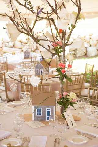 wedding-reception-tent-on-marthas-vineyard-shingle-style-home-and-branch-centerpiece-rustic