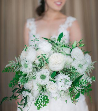 bride-holding-white-flower-greenery-bouquet-loose-freshly-picked-garden-rose-roses-ferns