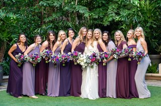 wedding-portrait-bride-in-marchesa-wedding-dress-and-bridesmaids-in-purple-dresses-matching-bouquets