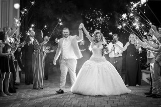 black-and-white-photo-of-ashley-alexiss-and-husband-wedding-grand-exit-sparklers