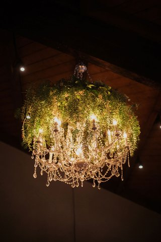 wedding-decor-crystal-chandelier-covered-with-greenery