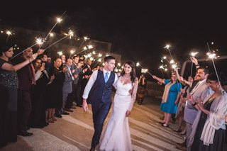 guests-create-a-pathway-and-sendoff-the-couple-with-sparklers
