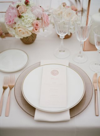 wedding-reception-with-charger-plate-napkin-china-and-menu-card-with-wax-seal-and-rose-gold-fork