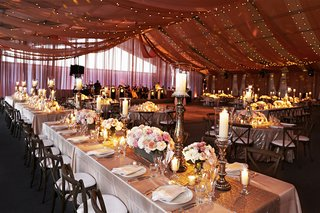 wedding-reception-under-drapery-and-string-lights-with-rustic-touches