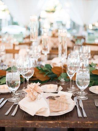 wedding-reception-wood-table-magnolia-leaf-garland-blush-bloom-wood-grain-menu-card-lavender-sprig