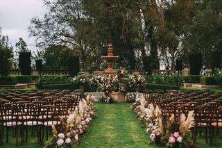 stephanie-perez-and-brandon-hampton-wedding-ceremony-outdoor-at-greystone-mansion-flowers-foliage