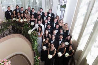 wedding-party-on-staircase-at-beverly-hills-hotel-tuxedos-and-black-dresses-mismatched-necklines