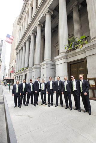 groom-and-groomsmen-in-front-of-nyc-building-in-sunglasses