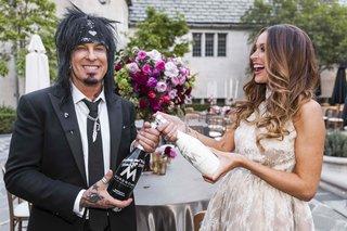 courtney-bingham-and-nikki-sixx-popping-champagne
