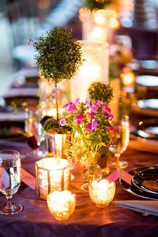 wedding-reception-long-table-purple-linen-candle-votive-green-topiary-barn-decor-rustic-elegant