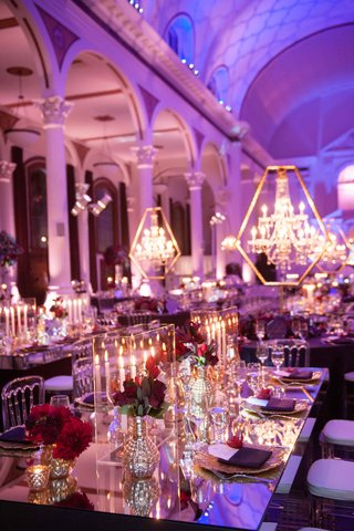 vibiana-wedding-reception-with-mirror-table-taper-candles-in-lucite-box-and-purple-lighting