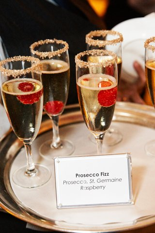 gold-sugar-rimmed-glasses-of-prosecco-with-raspberries