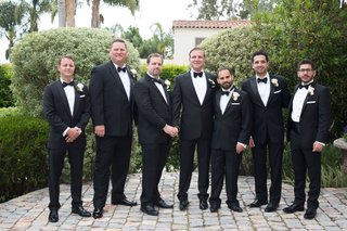 same-sex-wedding-friends-and-family-all-men-with-boutonnieres-tuxedos